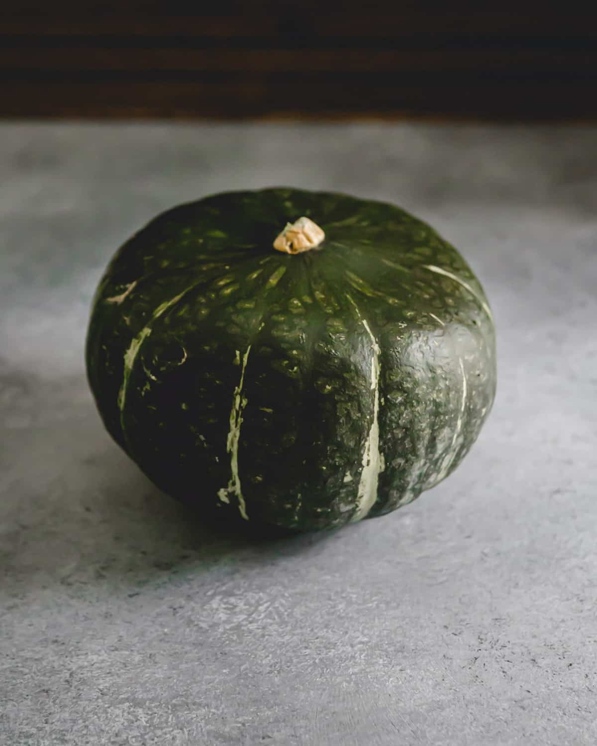 Whole buttercup squash before preparing and cooking.