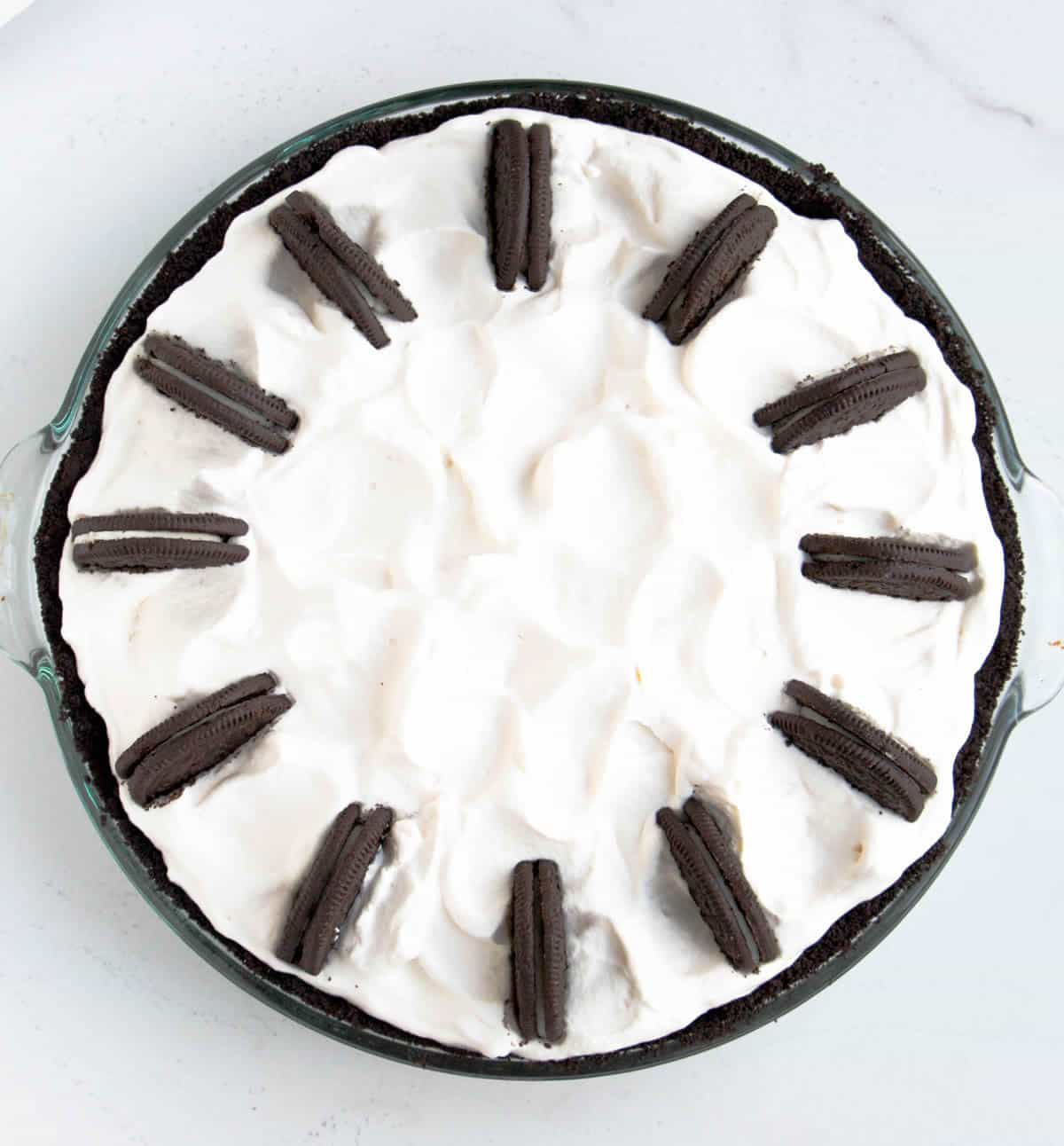 Cookies 'n Irish Cream Cheesecake Pie. There's Irish cream in the cheesecake, the ganache and the whipped cream. Cookies 'n cream just got more fun!