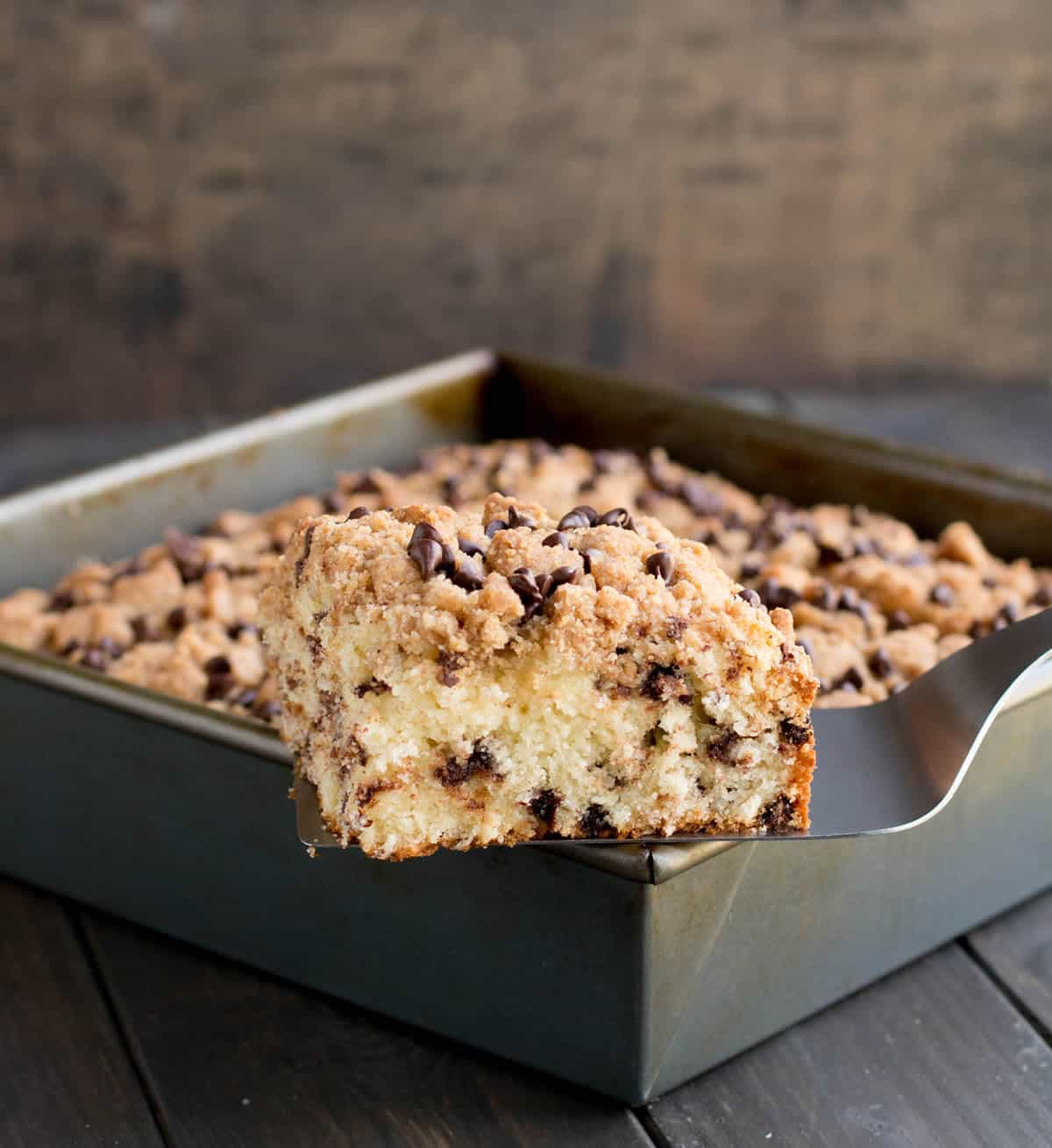 Chocolate Chip Crumb Cake. A delicious breakfast cake, rich with sour cream and butter, dotted with chocolate chips and crowned with a sweet crumb topping.