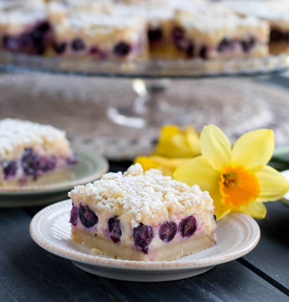 Lemon Blueberry Shortbread Bars. A thick, soft shortbread crust is topped with a lemony custard, fresh blueberries and a lemon crumb topping!