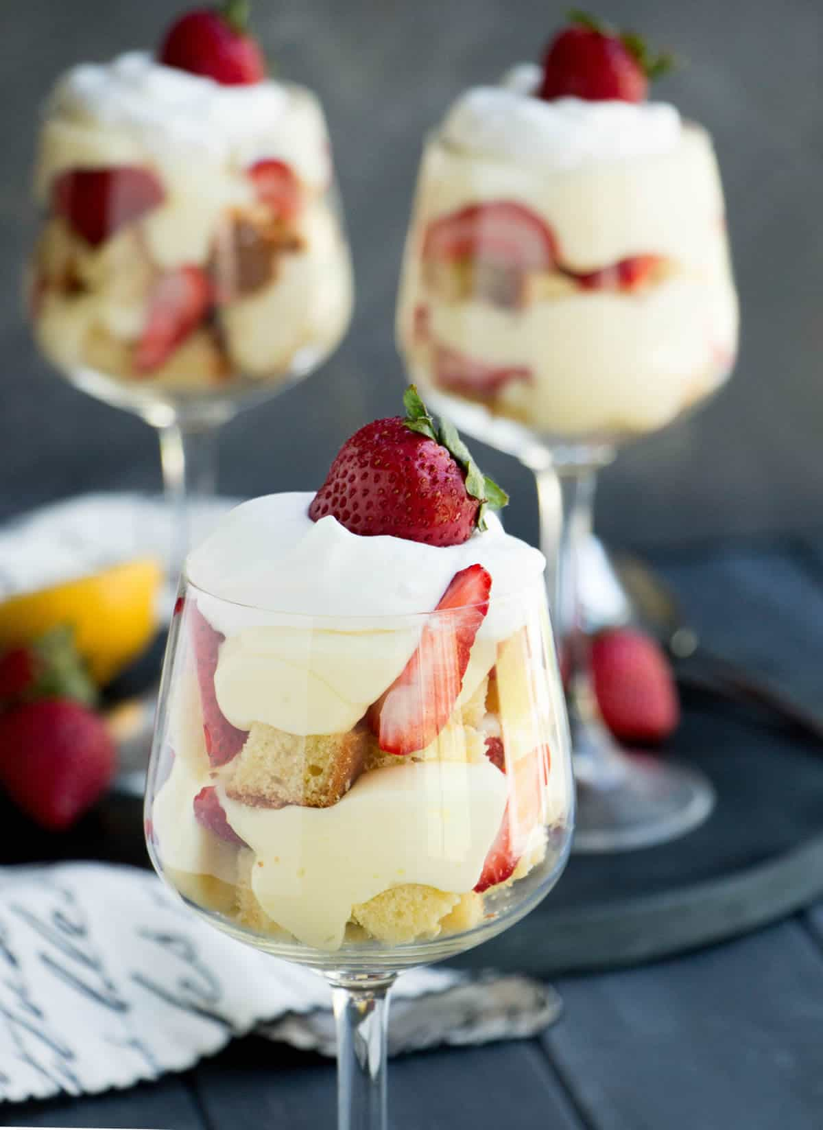 Strawberry Lemon Pound Cake Trifles. Triple citrus pound cake is layered with a no bake lemon curd cheesecake filling, fresh strawberries and whipped cream!