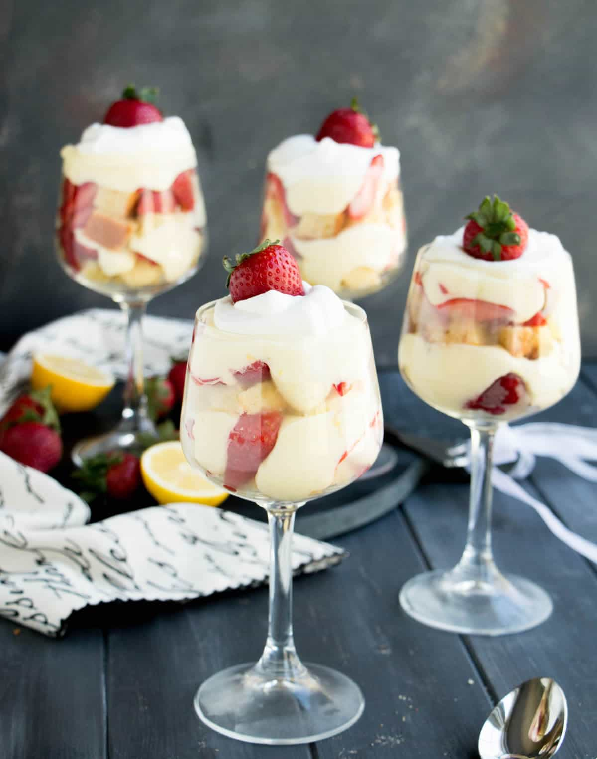 Strawberry Lemon Poundcake Trifles. A triple citrus poundcake is layered with a no bake lemon curd cheesecake filling, fresh strawberries and whipped cream!