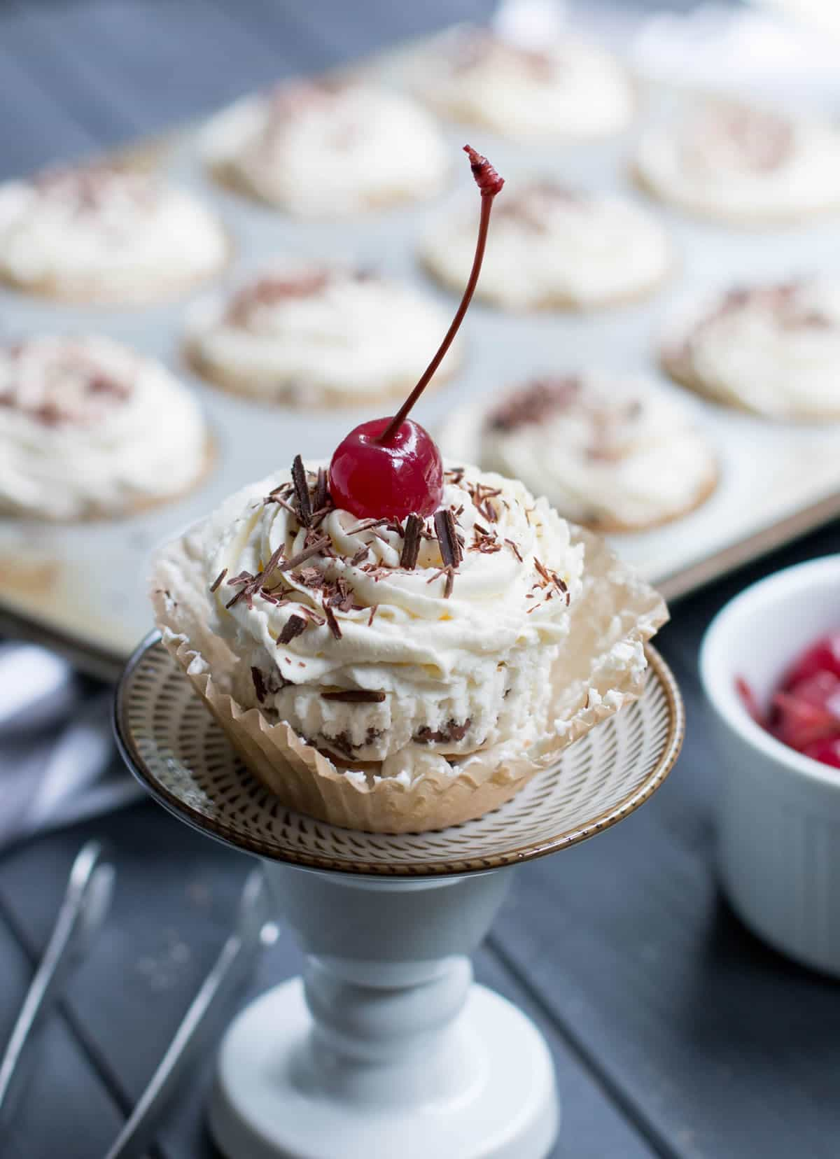 No Bake Ice Box Cannoli Cupcakes. Easy, one bowl ricotta filling is layered with vanilla wafers, topped with whipped cream, chocolate shavings and a cherry!