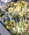 Cheesy Pepper Jack Roasted Brussels Sprouts with freshly grated pepper jack cheese make for the best side dish! They are very easy to make and come together on on sheet pan! Tender, crisp brussels sprouts are roasted with garlic, pepper jack cheese, and onions. #sheetpan #sheetpanrecipes #brusselssprouts #cheesybrusselssprouts | https://withpeanutbutterontop.com