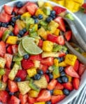 Bowl filled with fruit and tossed with a honey lime and poppyseed dressing.
