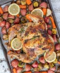 Lemon Garlic Butter Butterfly Chicken and Veggies. A pan of chicken and vegetables.