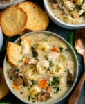 Bowls filled with creamy soup with mushrooms, tortellini and chicken. Served with toasted bread.