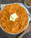 Creamy Mashed Sweet Potatoes - creamy, fluffy sweet potato perfection! Full of brown sugar, cinnamon flavoring, but on the lighter side! Perfect side dish for your holiday gatherings! #mashedsweetpotatoes #sweetpotatoes #thanksgiving #thanksgivingdinner | https://withpeanutbutterontop.com