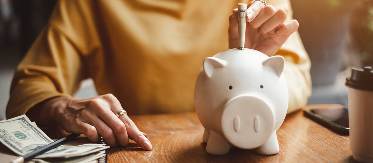 Piggy bank with money symbolic of how insurance claims are paid