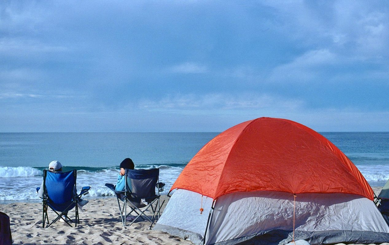 people camping at a beach