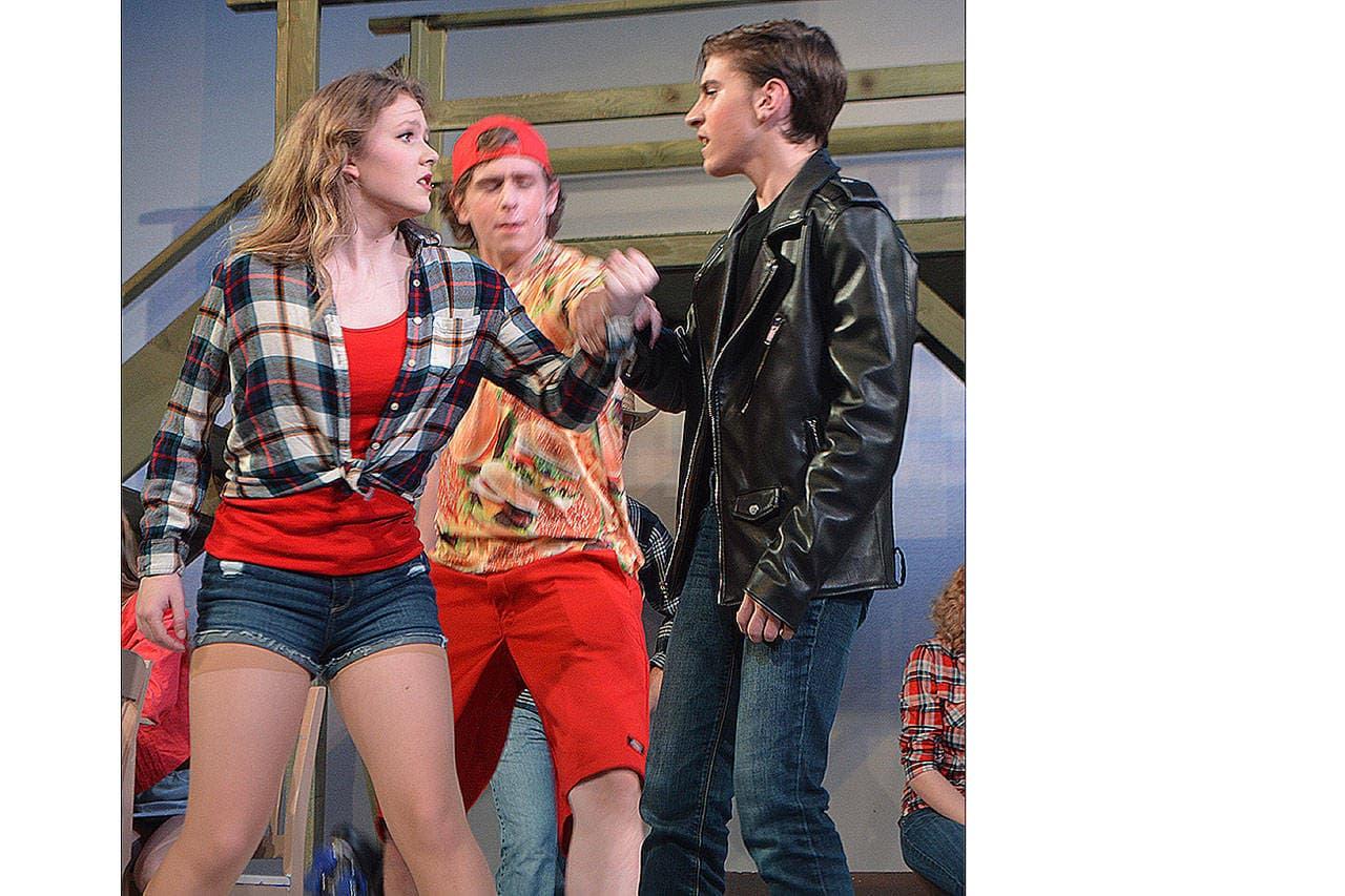 Steve Powell/Staff Photos                                  Ren (Kael Bartness) steps in to break up an argument between Aerial (Audrey Stich) and bad boy boyfriend Chuck Cranston (Landon Howe).