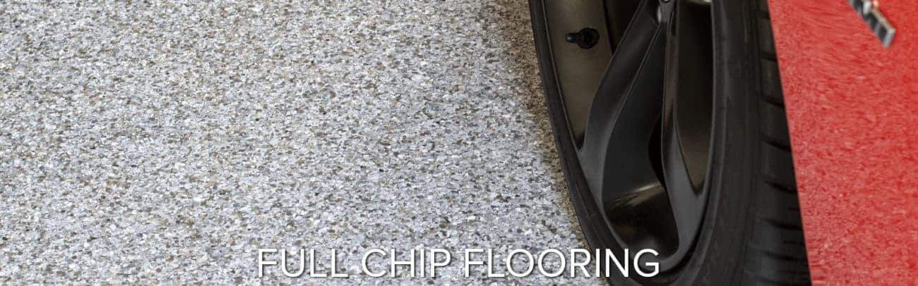 full-chip epoxy coatings polyaspartic polyurea garage floor coating red car on garage floor GarageFloorCoating.com