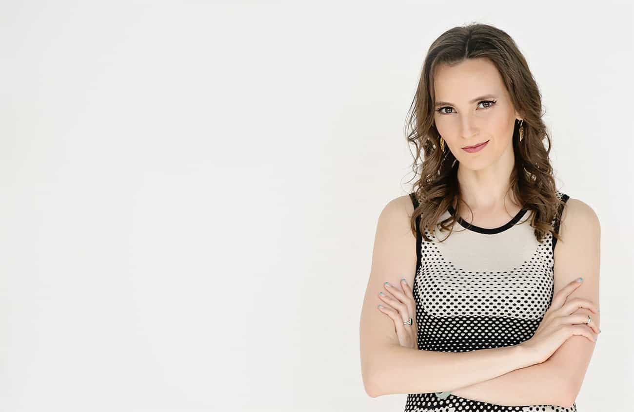 Nathalie Lussier posing with arms crossed
