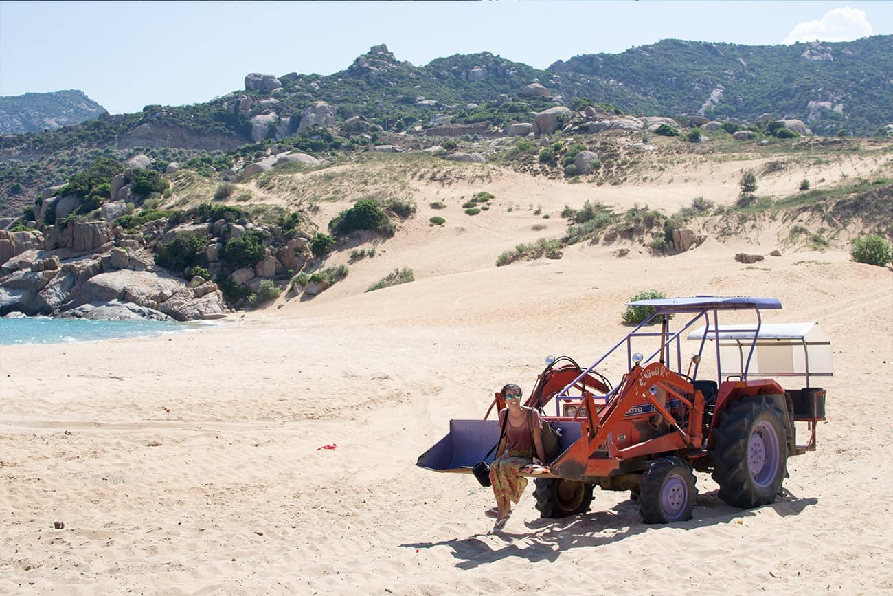 With the tractors shovel to the beach