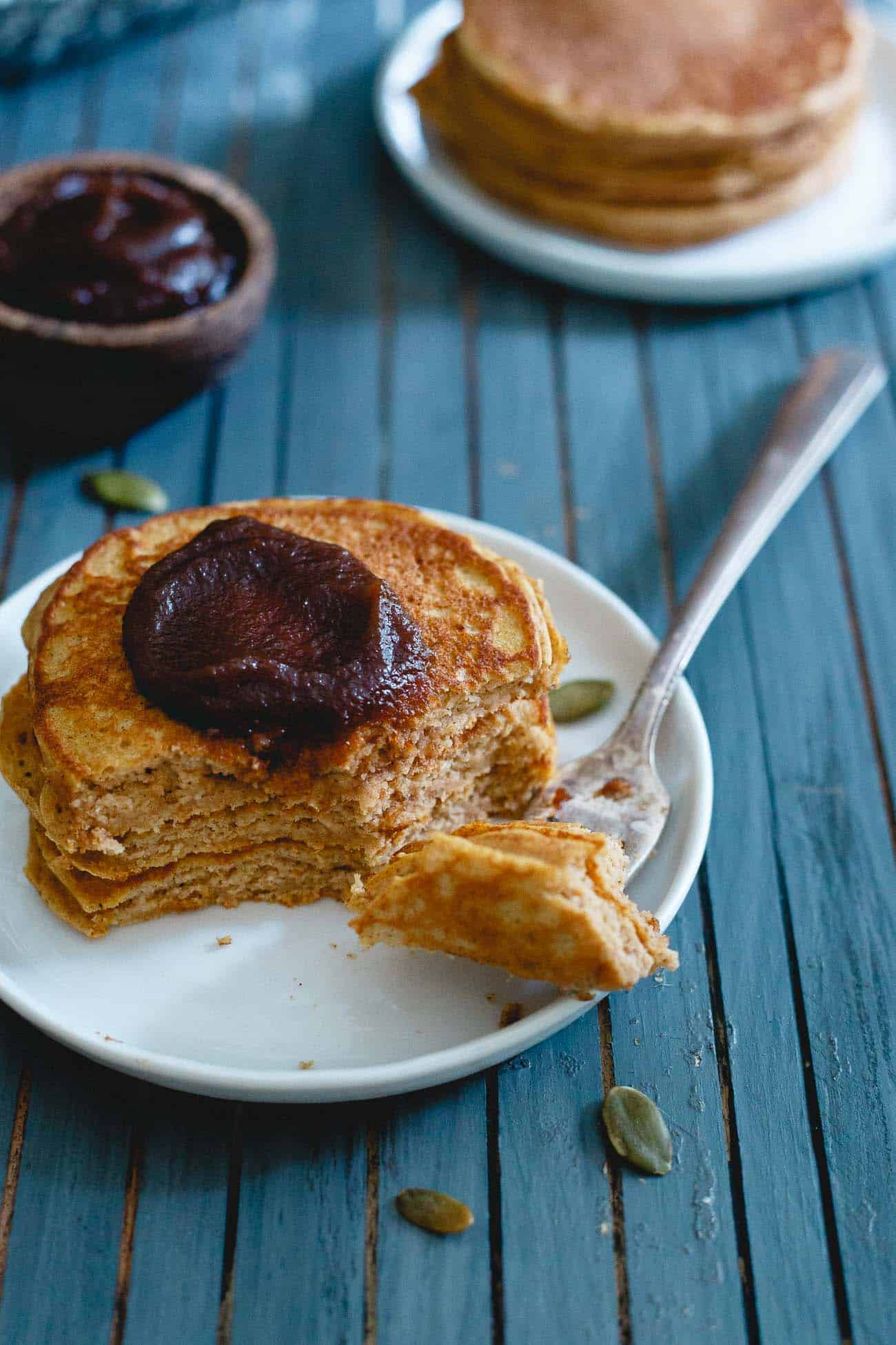 This fluffy, fall spiced stack of pumpkin protein pancakes is the perfect start to your morning.