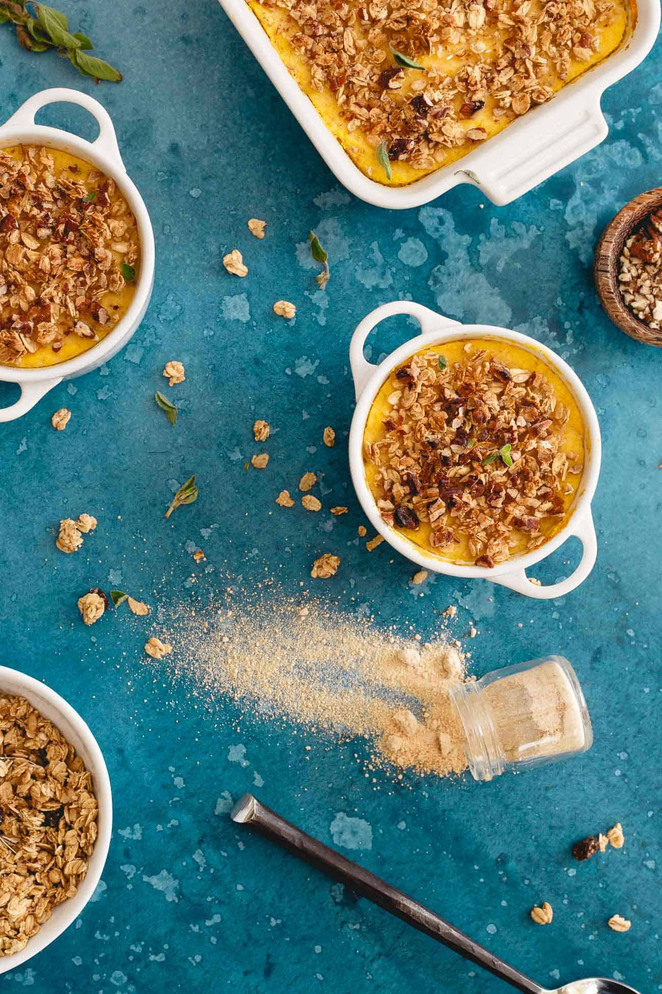This cauliflower pumpkin mash is made with creamy marscapone and topped with vanilla granola and pecans. A healthier alternative to sweet potato casserole!