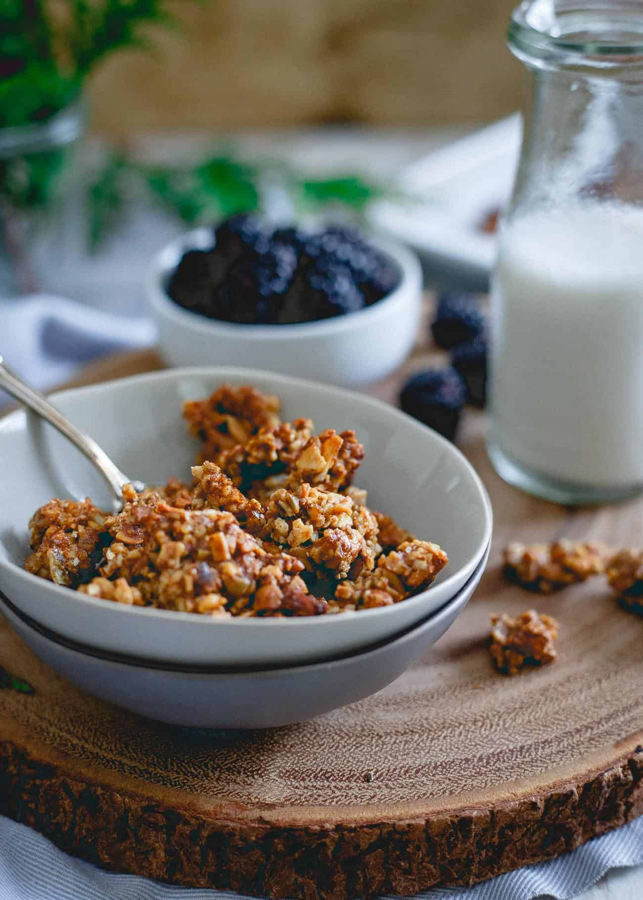 This paleo gingerbread granola is made with all the good stuff, just nuts, seeds and natural sweeteners with a wintertime twist perfect for the holidays.