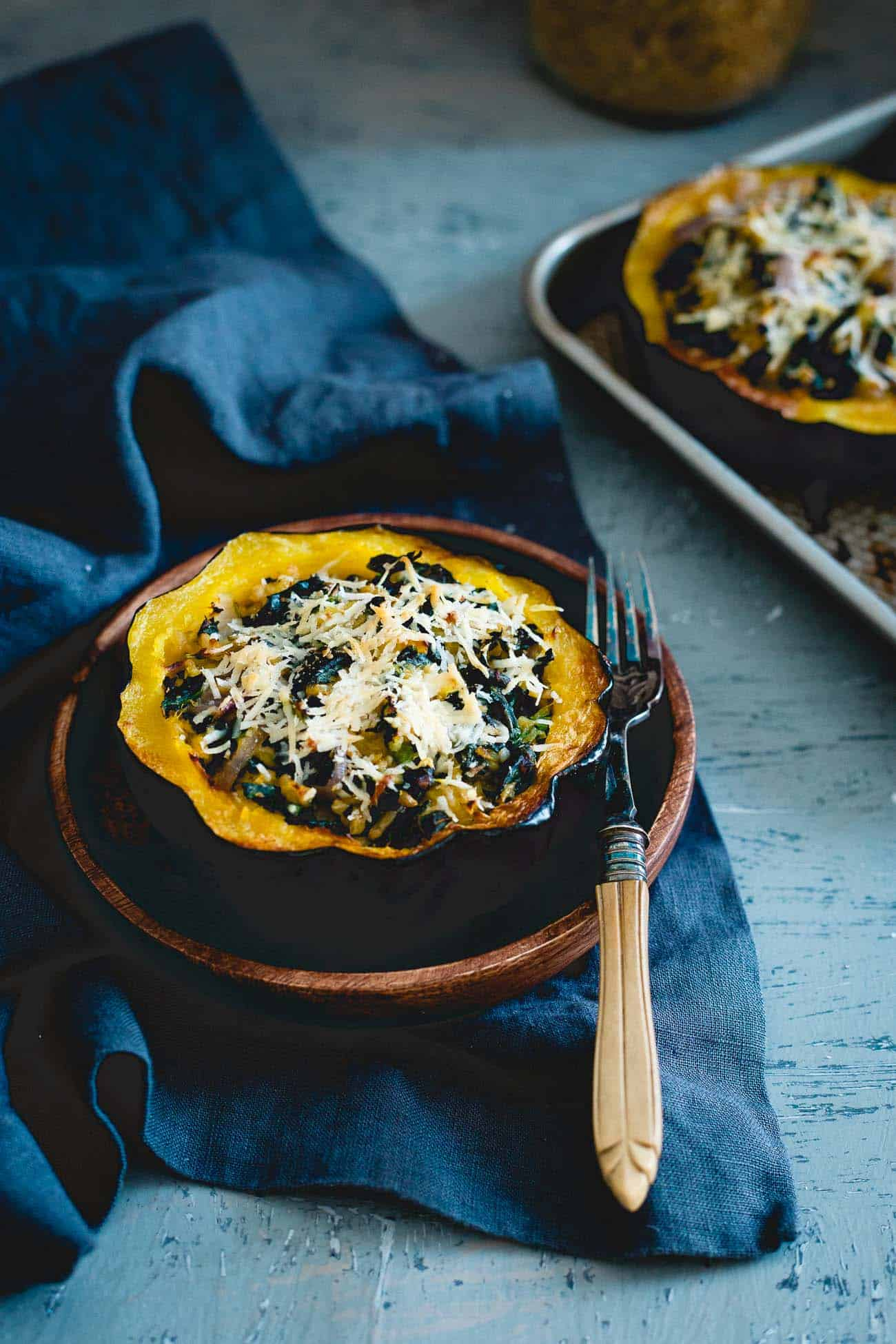This twice baked acorn squash is stuffed with tuscan kale, hearty freekah and pecorino romano for a lovely fall side with a hidden protein boost.