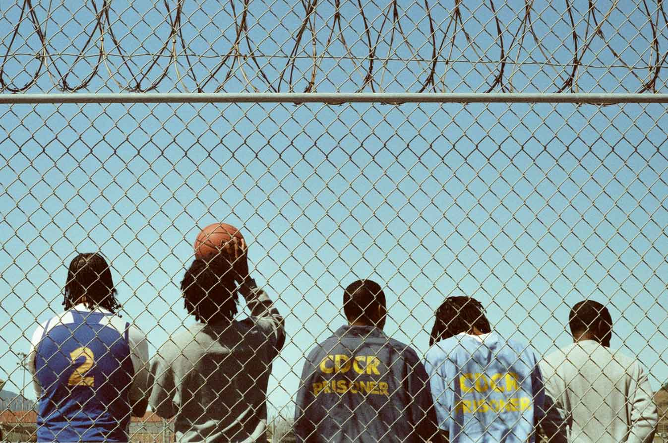 Q Ball Film Images - Inmates Behind Fence