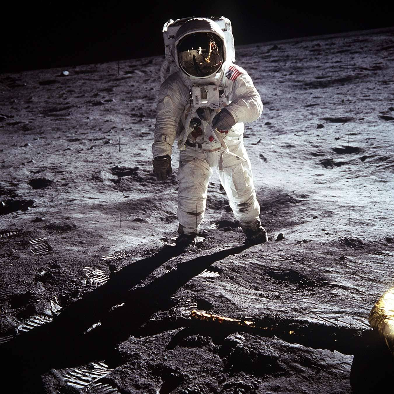 Astronaut Buzz Aldrin walks on the surface of the moon near the leg of the lunar module Eagle during the Apollo 11 mission. (Image Credit: NASA)
