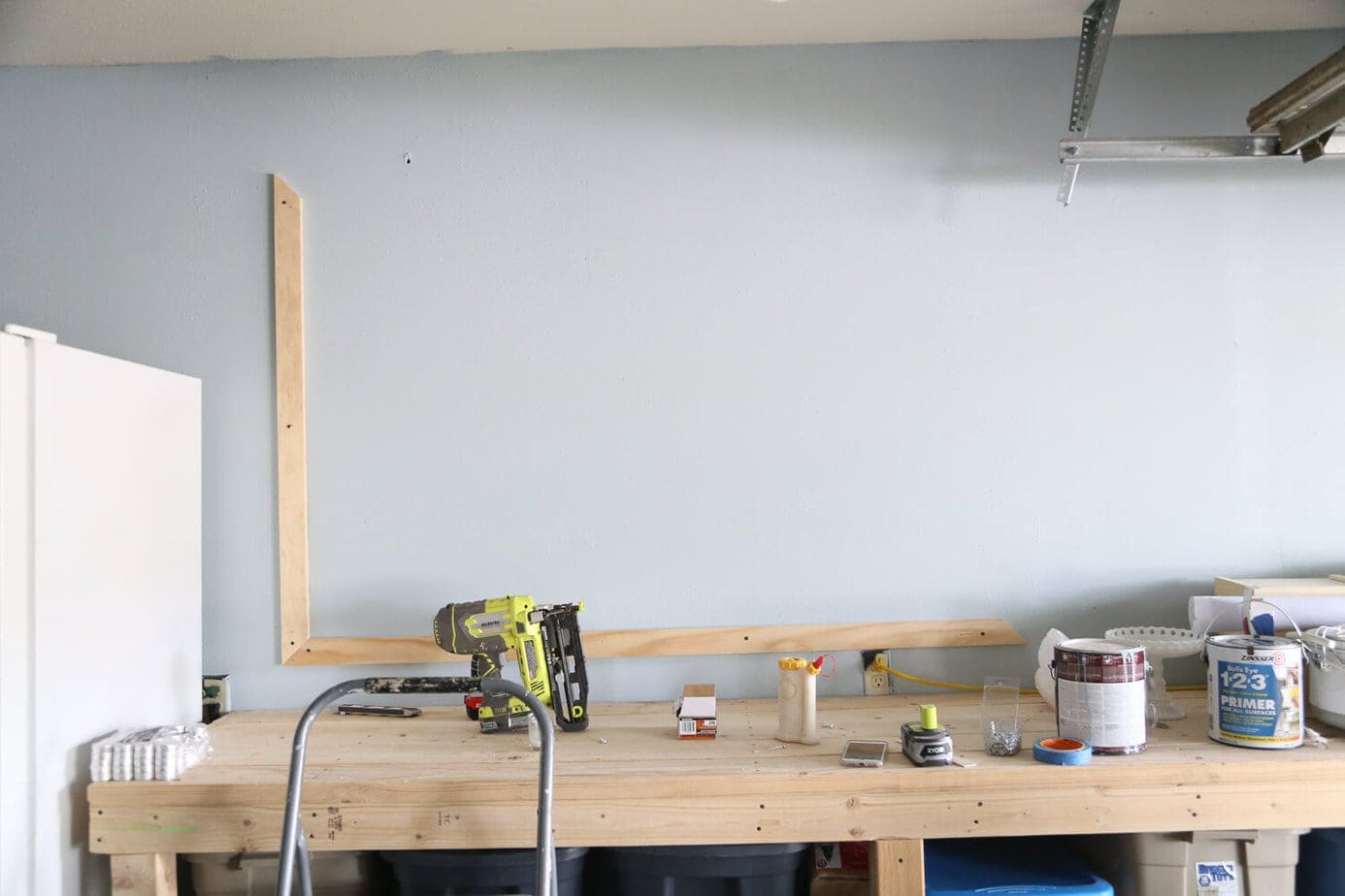 two boards added to wall for chalkboard frame
