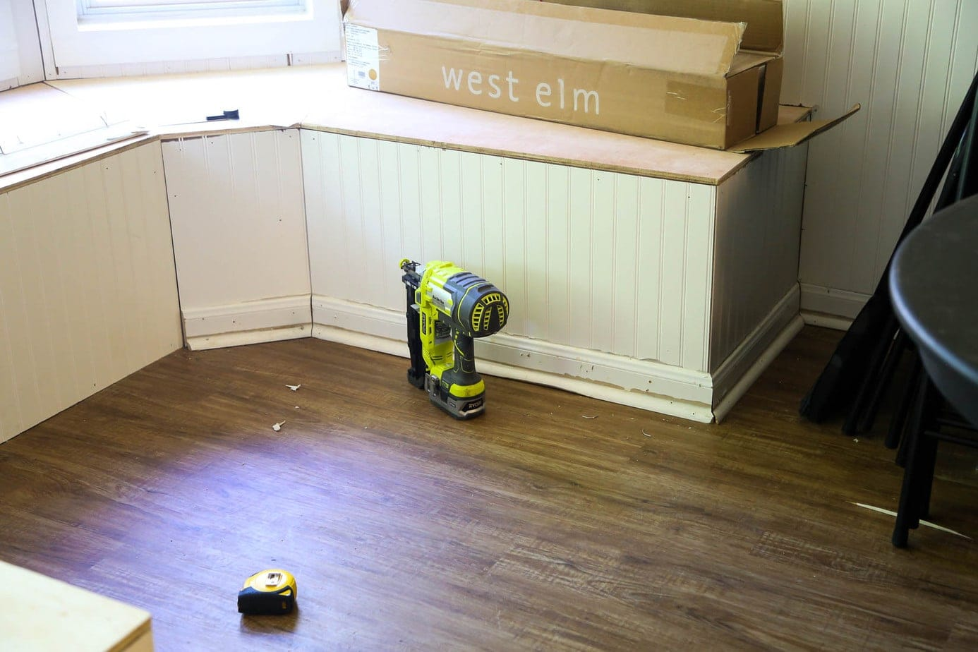 Installing baseboards for DIY bay window bench