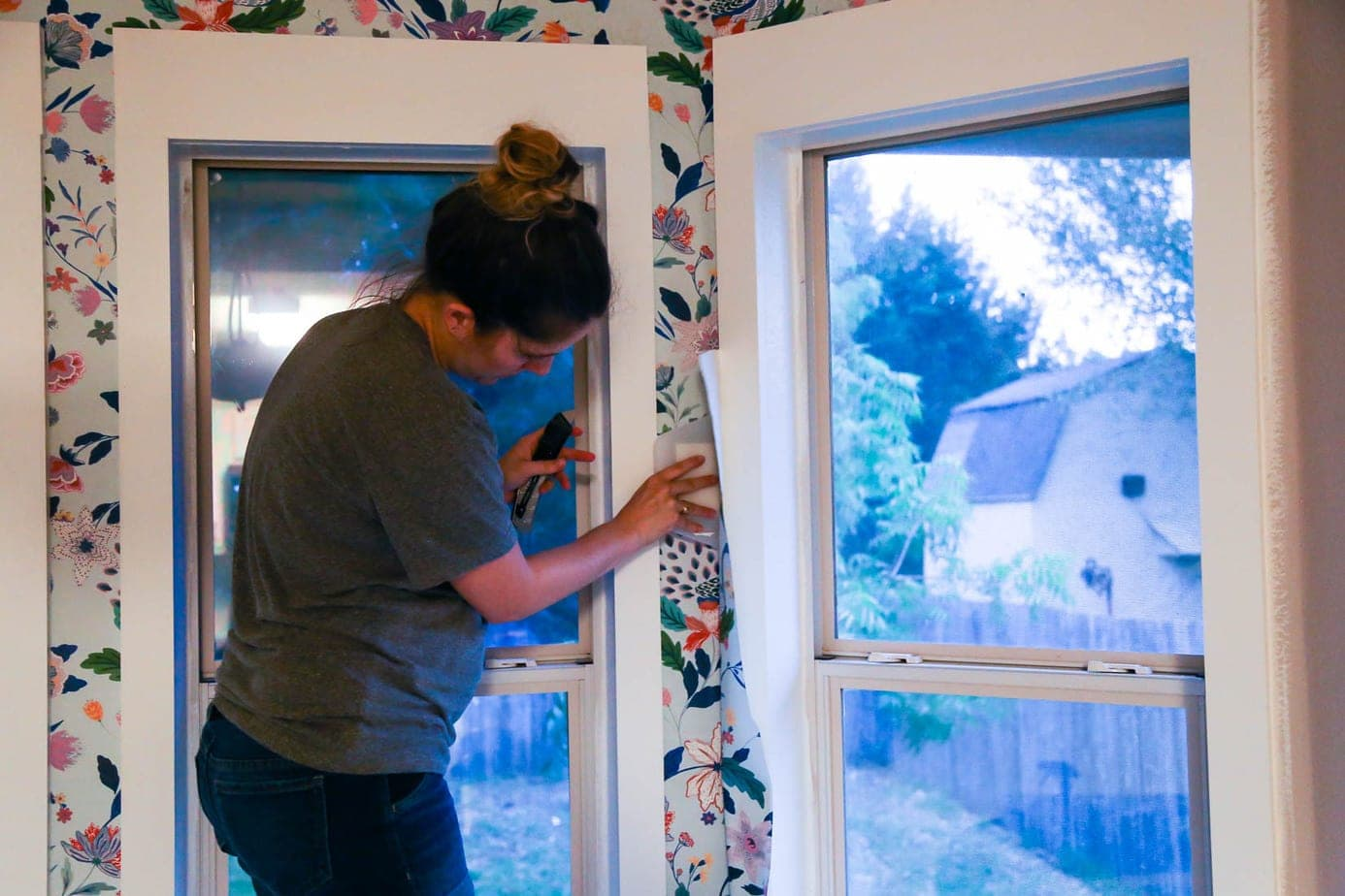 Installing wallpaper around a window