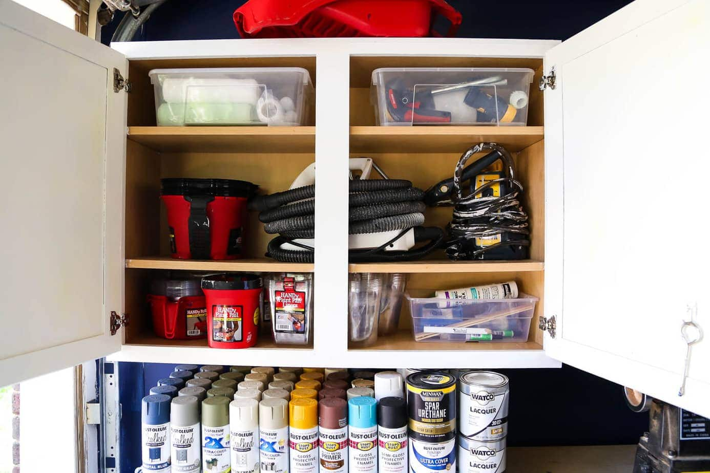 Using an old cabinet to organize paint supplies