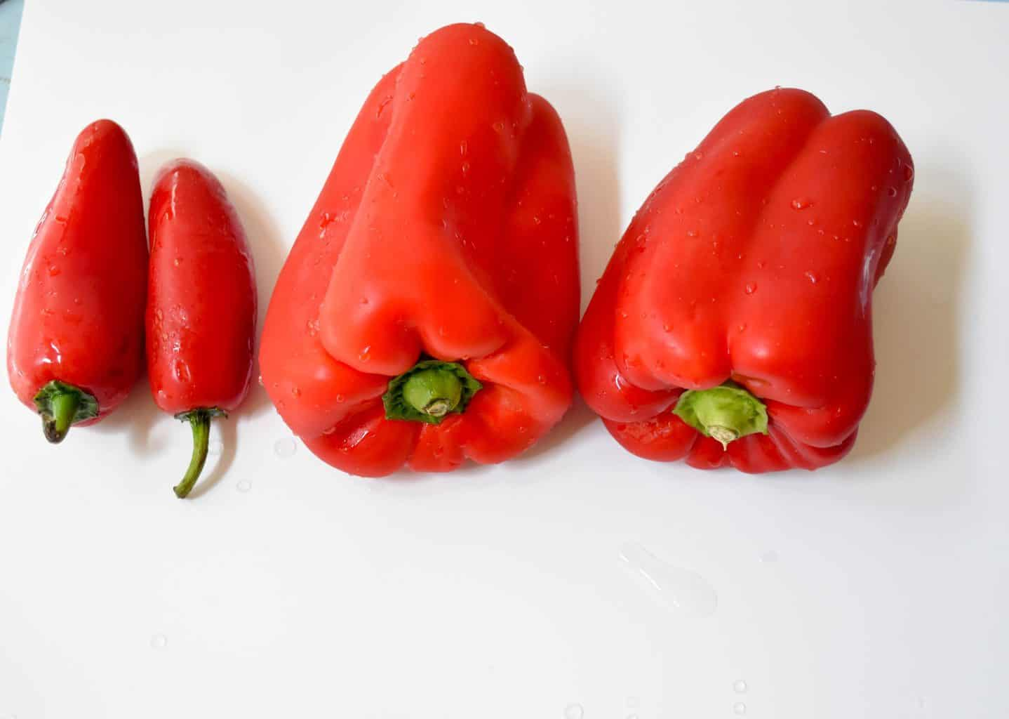 """<img src=""""https://cdn.shortpixel.ai/client/q_glossy,ret_img,w_2560,h_1823/peppers.jpg"""" alt=""""Red bell pepper and Red Jalapenos"""">"""