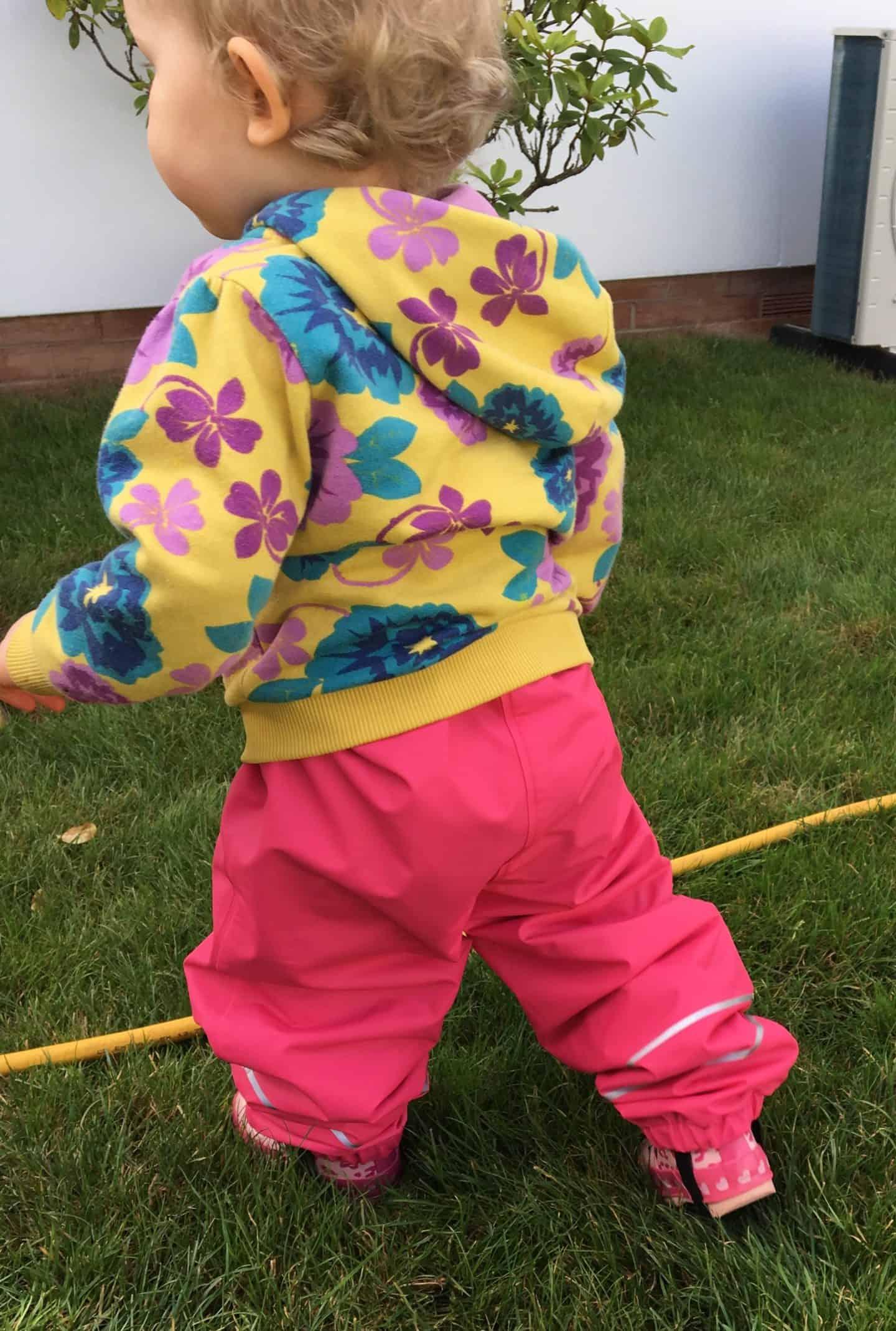 baby girl wearing dry kids raspberry fleece lined dungarees