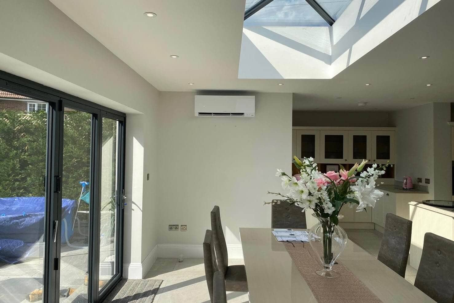 SubCoolFM wall mounted air conditioning in Staines kitchen living space extension showing end of extension by dining area and windows