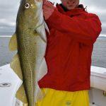 Man Holding Deep Sea Cod