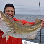 Man Holding Deep Sea Cod Catch