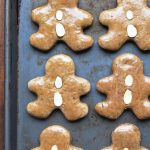 Lebkuchen Gingerbread Men with almond buttons on baking sheet