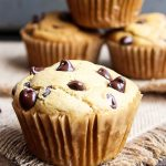 Peanut Butter Muffin with chocolate chip. More muffins and peanut butter on spoon in background