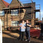 happy customers with new roof funding