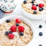 Two bowls of maple cinnamon oatmeal on a breakfast table