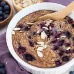 Baking dish with blueberry oatmeal and sliced almonds on top