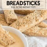 whole wheat breadsticks with parmesan and herbs with a bowl of soup