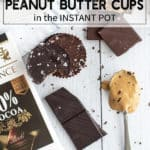 Chocolate peanut butter cups stacked on top of each other on a white surface with a scoop of peanut butter