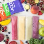 packets of freeze dried fruit surrounded by fruits and vegetables