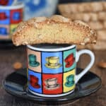 a sourdough biscotti on a coffee cup
