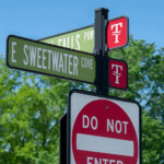 decorative street signage on a neighborhood road