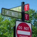 decorative street signage on a neighborhood road