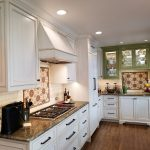 After: Custom colored refinish on kitchen cabinets