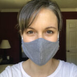 Kristen wearing a homemade gray fabric mask
