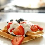 waffles with berries and whipped cream