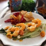 Grilled Buffalo Shrimp on grilled Romaine lettuce on a plate - zagleft.com