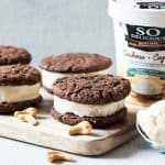 These Frozen Dessert Cookies Sandwiches are a perfect vegan treat. Creamy frozen cashewmilk is layered in between flourless cashew chocolate cookies for a delicious summer dessert.