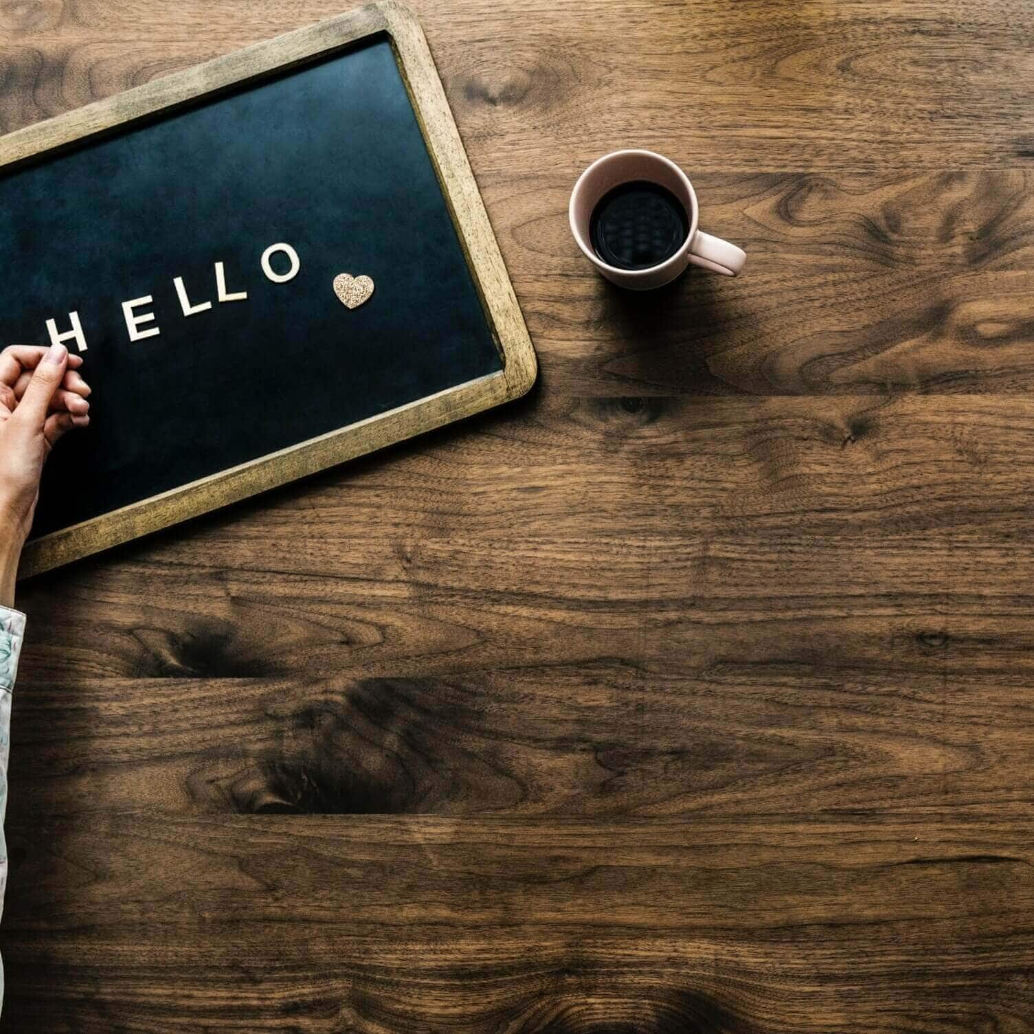 picture of a blackboard with the word hello next to a coffee mug. Picture used as title for blog post